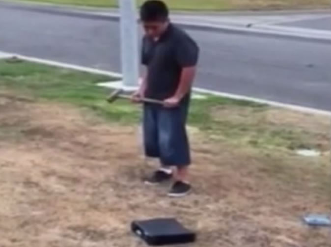 Boy forced to destroy his Xbox after getting bad marks